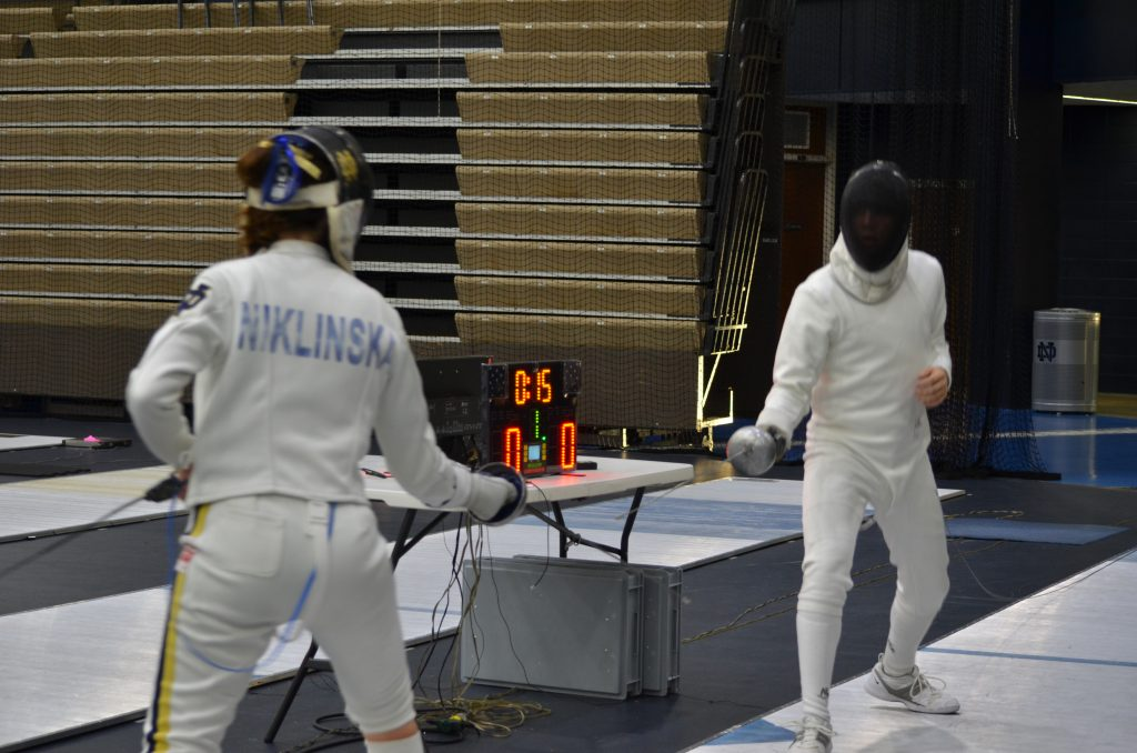 David fencing a member of Notre Dame's team